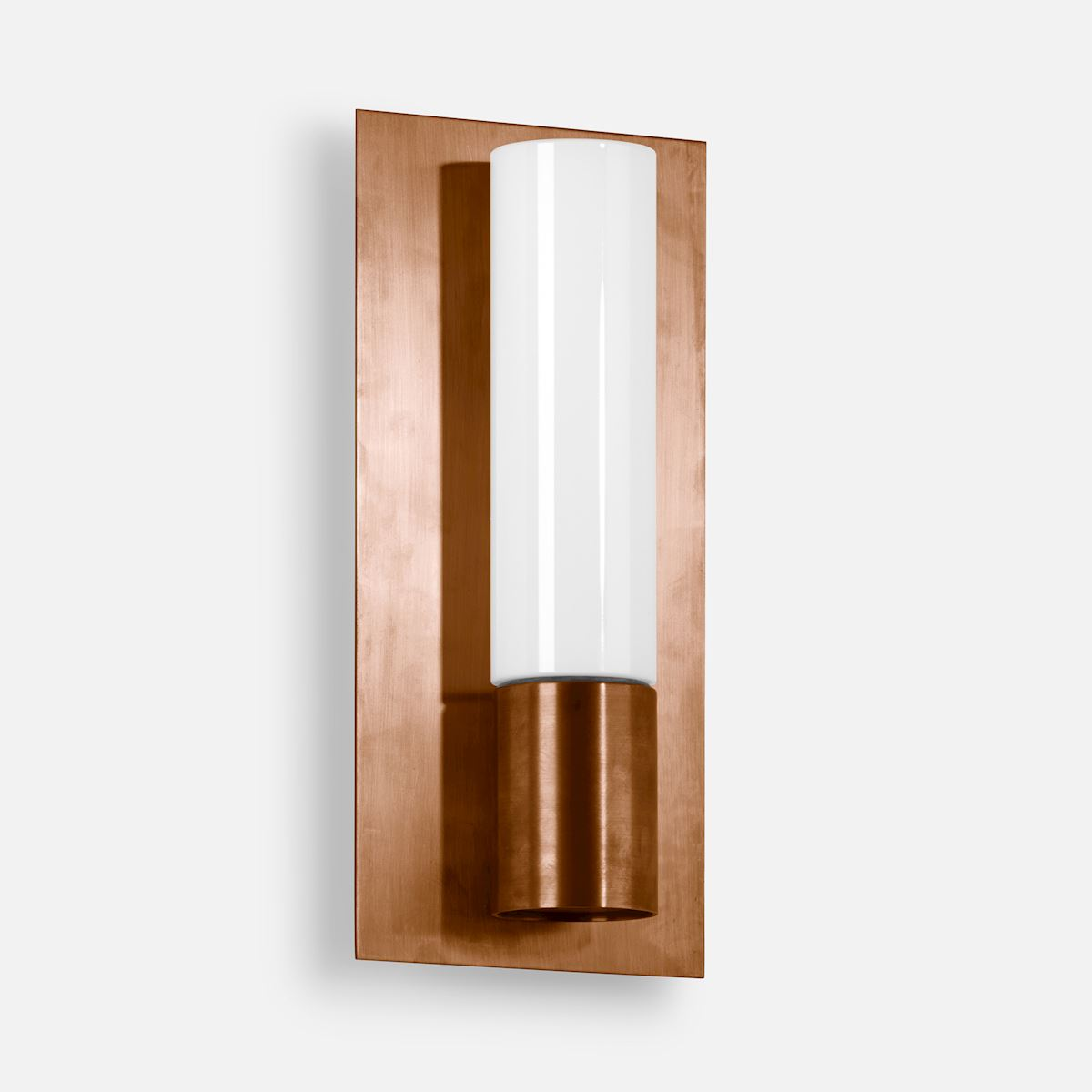 Cast bronze, copper and brass wall luminaire